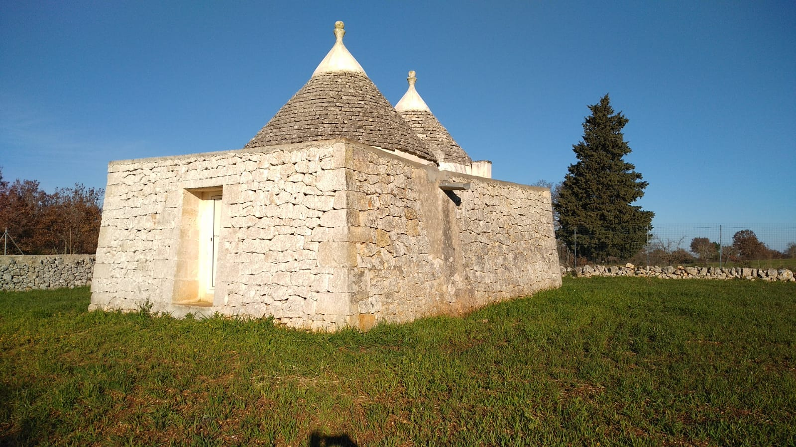 Panoramic trullo for sale with plot of land